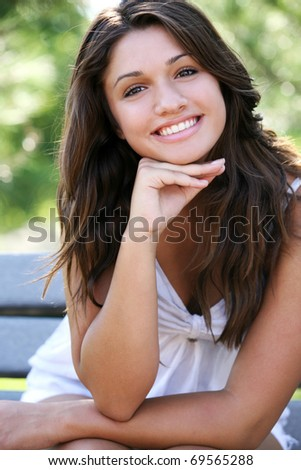 Young attractive happy girl posing outdoor.