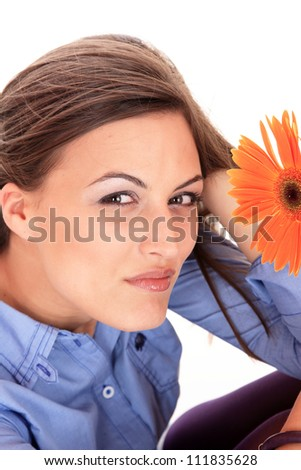 Young attractive happy woman with sunflower