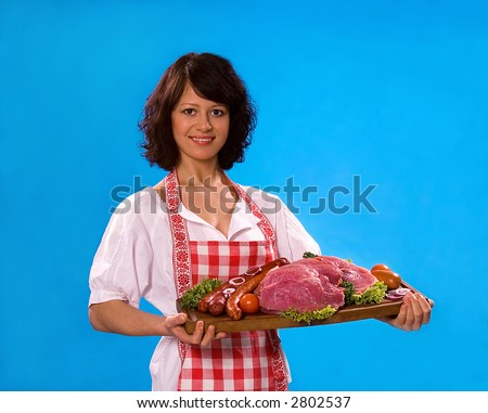 Young attractive housewife offers meat products, isolated on white background