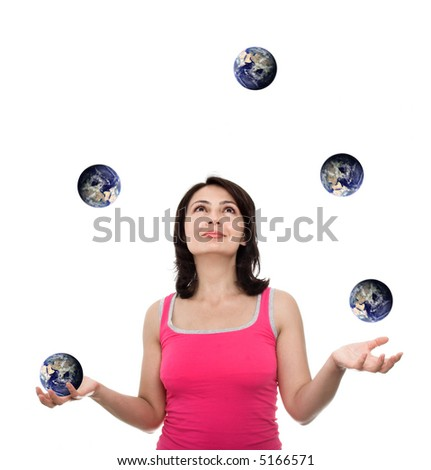 young attractive juggler plying with earth (earth image courtesy of NASA-visible earth-)