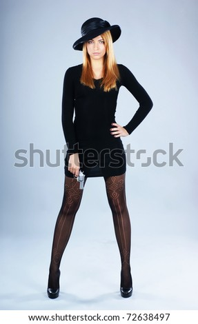 Young attractive killer widow over grey background