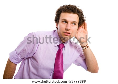young attractive male adult, pink shirt and tie listening carefully, spying, all isolated on white background