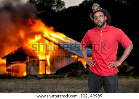 Young attractive male American man firefighter ready for work - stock photo