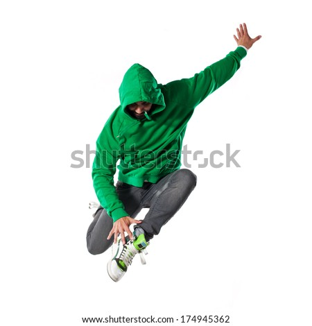 Young attractive male dancer performing hip hop dance. Isolation on white