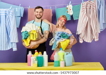 young attractive man and woman having break while doing household chores. housewife holding her arm on her husband's shoulder . close up portrait.spare time, free time