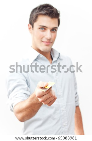 Young attractive man giving credit card