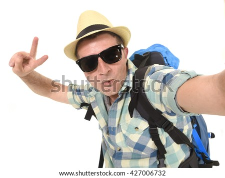 young attractive man or backpacker student taking selfie photo alone with  mobile phone or camera wearing e919821df9fb