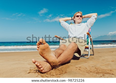 Young Attractive Man Relaxing at the Beach
