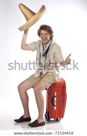 Young attractive man taking his hat off and hitchhiking