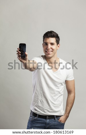 young attractive man taking pictures of him self with phone-selfiy