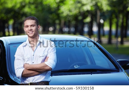 Young attractive man with car