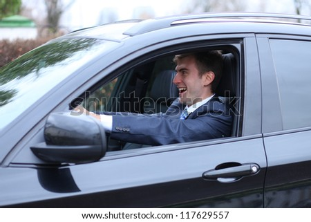 young attractive man young man in the car