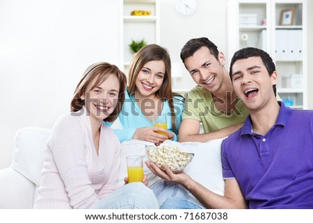 Young attractive people in the apartment