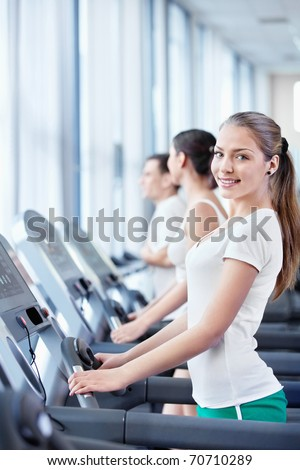 Young attractive people in the fitness club
