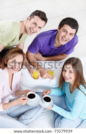 Young attractive people with drinks