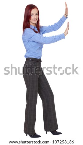 Young attractive redhead businesswoman push something - stock photo