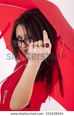 Young attractive sexy woman in red dress and with red umbrella showing love sign.