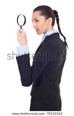 young attractive smiling business woman looking into a magnifying glass, isolated on white background