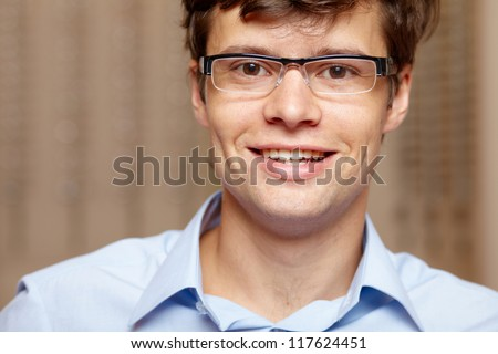 Young attractive smiling man at optician with glasses, background in optician shop - Shutterstock ID 117624451