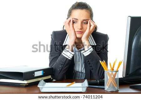 young attractive tired, overworked and exhausted female office worker in grey suit, isolated on white