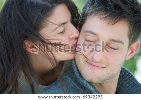 Young attractive white couple embracing each other
