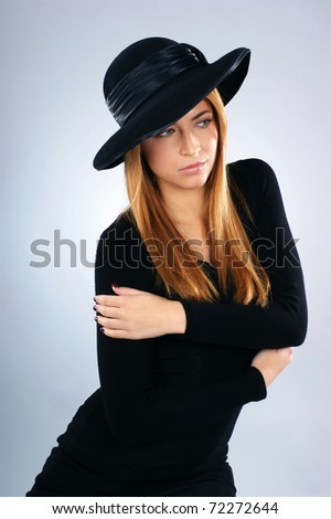 Young attractive widow over grey background