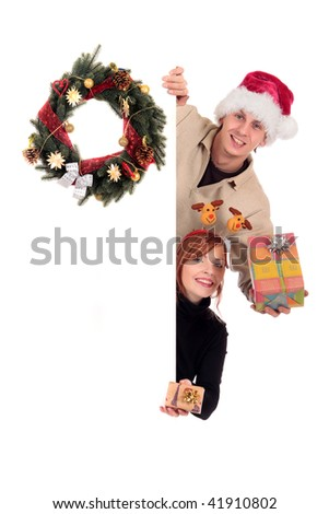 Young attractive woman and man, couple offering a Christmas present. Studio, white background.