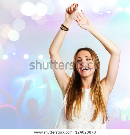 Young attractive woman dancing to the beat with disco background.
