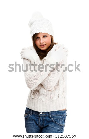 Young attractive woman dressed in winter clothes isolated on white background - stock photo