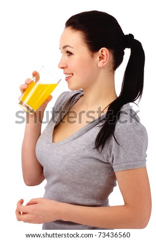Young attractive woman drinks orange juice, isolated over white