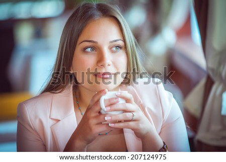 Young Attractive Woman Enjoying A Cup Of Coffee in Cafe Photo stock ©
