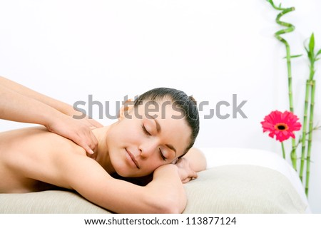 Young attractive woman enjoying neck massage.