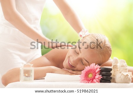 Young attractive woman getting massaging treatment