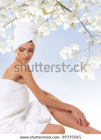 Young attractive woman getting spa treatment isolated on white