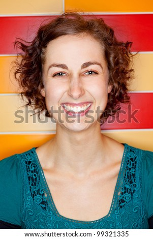 Young attractive woman grining with colorful tiles in the background
