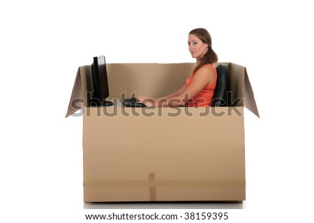 Young attractive woman having a chat session, chat box, cardboard box representing chat room.  Studio, white background