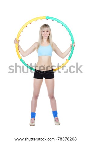 Young attractive woman holding hula hoop isolated over white background. Sport concept of girl exercising with hula hoop, twirling. Vertical shot.