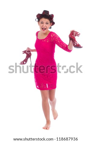 Young attractive woman in elegant short dress run carrying high heel shoes isolated on white background