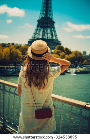 young attractive woman in hat ...