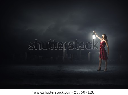 Stock Photo Young attractive woman in red dress with lantern