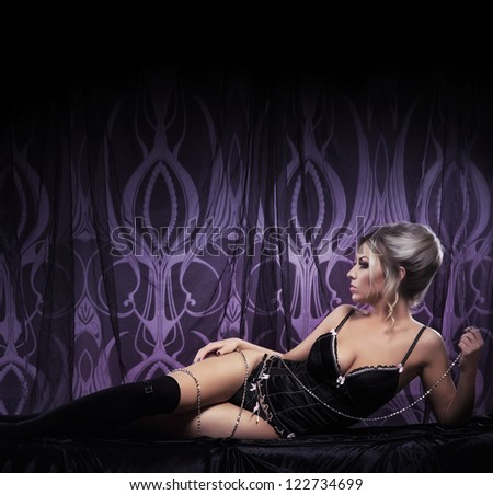 Stock Photo Young attractive woman in sexy lingerie posing in luxury interior
