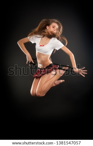 Young attractive woman in short top and skirt jump #1381547057