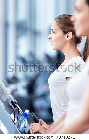 Young attractive woman in the fitness club
