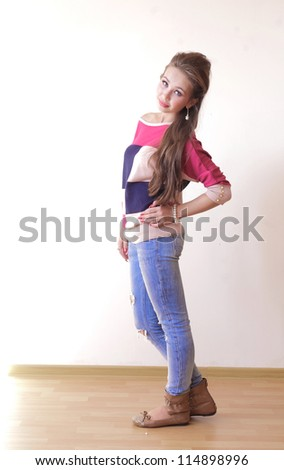 Young attractive woman looking at camera with confidence indoors full length