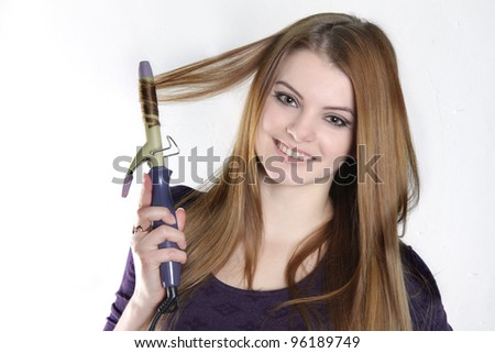 young attractive woman making hair style over white