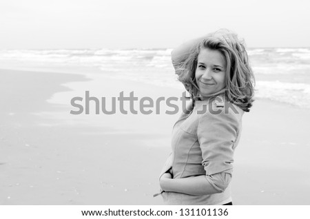 Young attractive woman near the sea on spring day