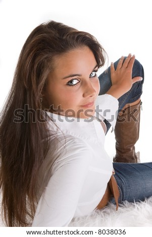 Young attractive woman posing on a white carpet