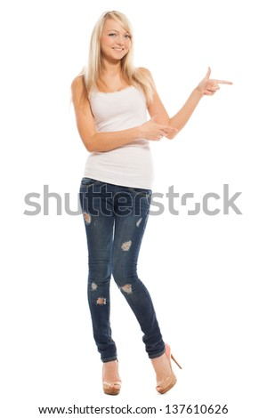 Young attractive woman shows on something isolated over white background