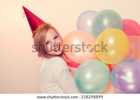 Young attractive woman smiling in amazement with a balloons