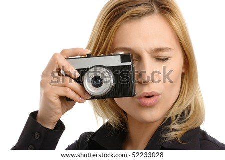 young attractive woman taking a shot with retro photo camera, isolated over white